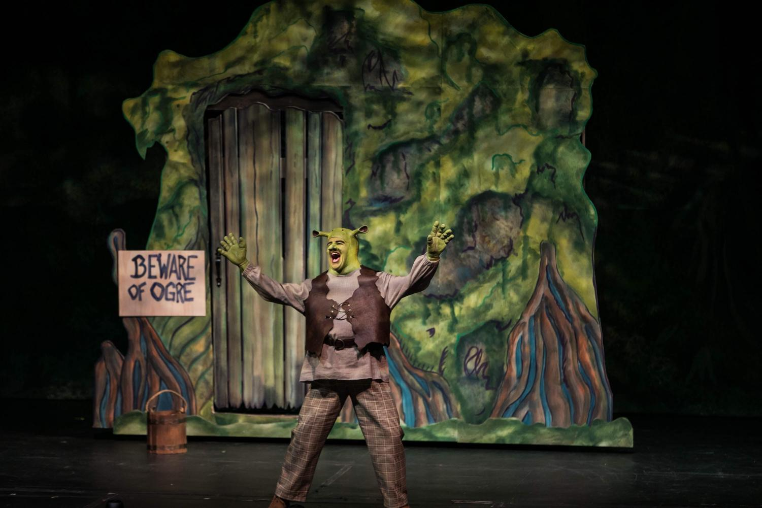 Newton in Shrek performing