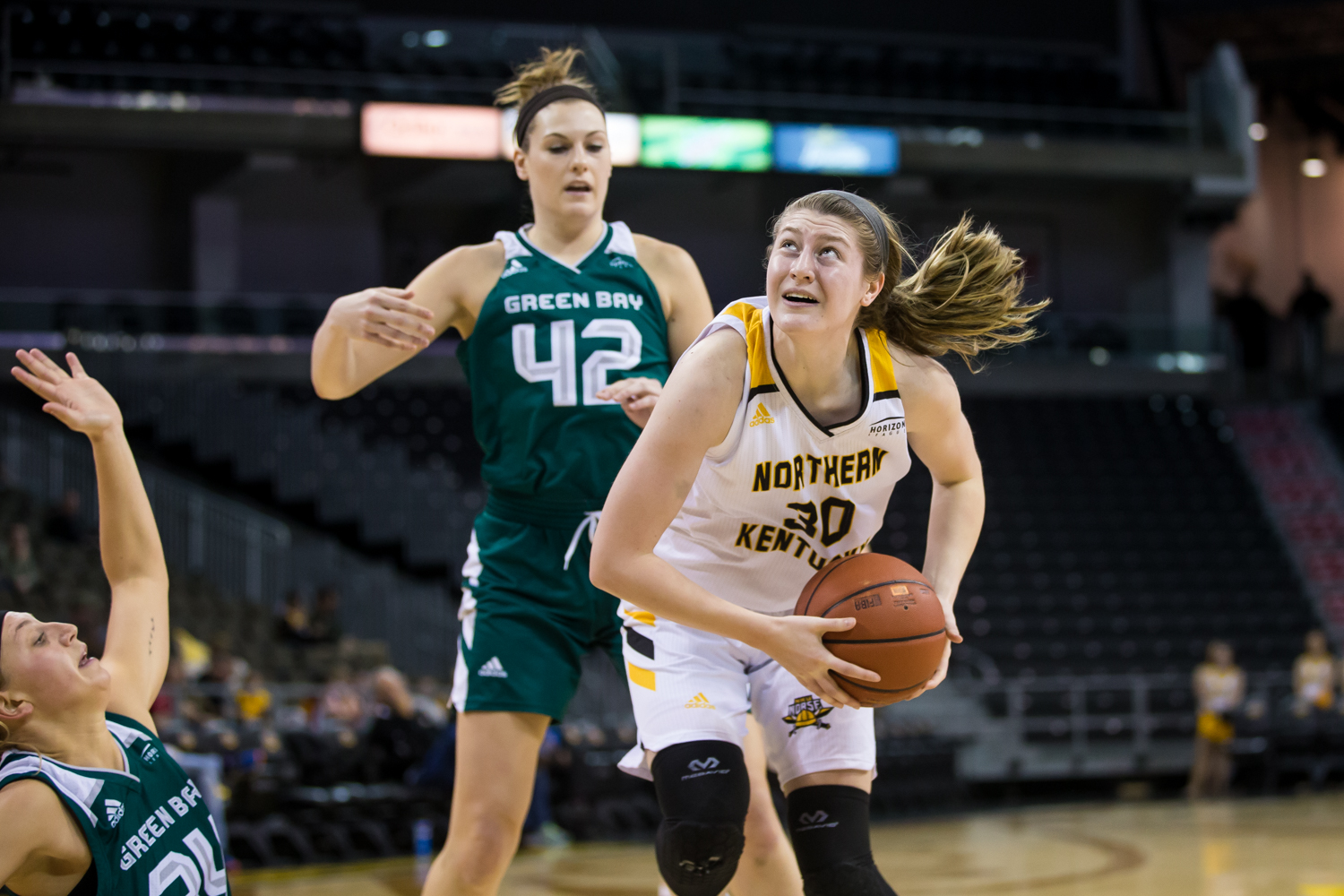 Emmy Souder (30) fights to shoot during the game against Green Bay. Souder shot 2-of-4 from three and had 10 points on the game.