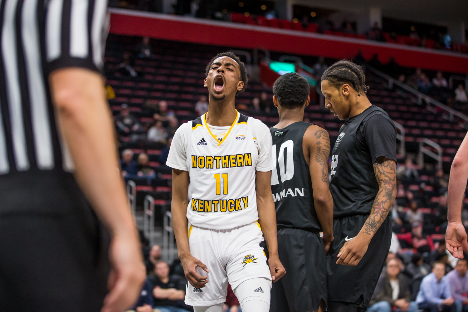 Jalen Tate (11) screams after earning a foul shot off a made basket during the semi-final game of the Horizon League Tournament against Oakland. Tate shot 6-of-18 and was credited with the assist on the game winning three by Drew McDonald (34).