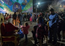 Children and their families line up to visit Santa during the celebrations. Photo credit: Chloe Jakiela