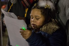 Resident Jasmine Vaughn sings a Christmas song during Observatory Hill's inaugural Light Up Night 2017. Photo credit: Chloe Jakiela