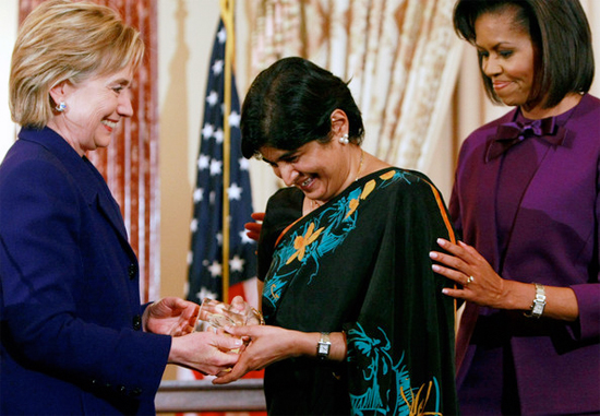 Ambiga between Hillary Clinton and Michelle Obama