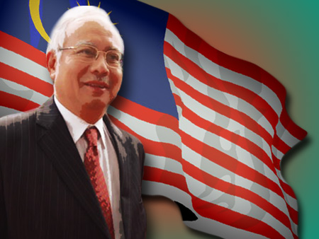 Prime Minister Najib Razak standing in front of a Malaysian flag