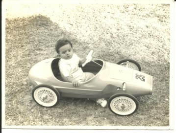 In his sports car, aged one