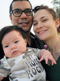 Aishah and her husband, Shaikh Abdul Shahnaz, with six-month-old Soraya in Penang on her first holiday