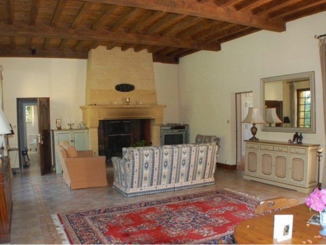 Main house living room. Huge ancient fireplace and wood ceilings.