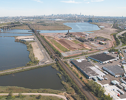 Photo courtesy NJMCAn aerial view of the Koppers Coke Peninsula in South Kearny with New York skyline in background.