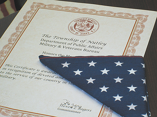 Photo by Ron LeirNutley presents this certificate and flag to the survivors of a deceased veteran.