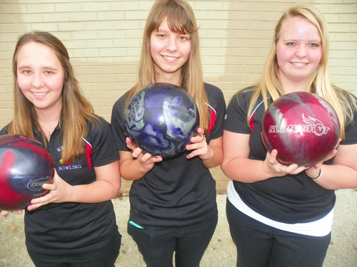 Photo by Jim HagueIt's all in the family, as the Stankus triplets, (from l.), Nicole, Kristen and Jennifer have been major reasons why the Kearny girls' bowling team is undefeated.