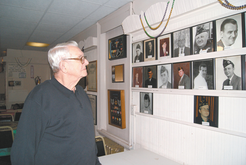 Photo by Karen Zautyk Ed Marshman with collection of portraits of past Post No. 282 Commanders.