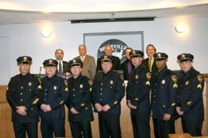 Photo courtesy Belleville P.D. New sergeants, from l., are: Ralph Marotti, Ken Henry, Graham Koshnick, Albert Henry, Ed Zimmerman, William Washington and John McAloon. Behind them, from l., are: Councilman Steve Rovell, Councilman John Notari, Mayor Raymond Kimble, Deputy Mayor Vincent Cozzarelli and Councilman Michael Nicosia.