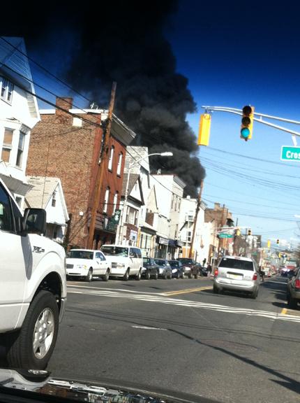 Photo courtesy Erin Fallon Smoke billows from scene of five-alarm fire in Harrison on Sunday.