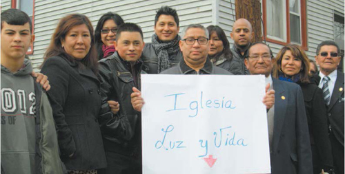 Photo by Ron Leir Congregants of Iglesia de Dios Luz y Vida gather in front of former church site.