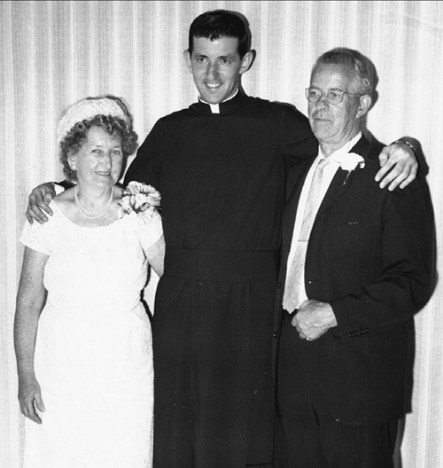 Photo courtesy of Msgr. Francis Seymour The Rev. Seymour with his parents, Mary Boyle Seymour and George Seymour, following his first solemn Mass, celebrated June 2, 1963, at St. Mary Parish, Bayonne.
