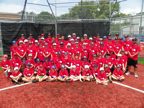 Photo by Jim Hague The participants, coaches and instructors all get together for a group shot at the second annual Kearny baseball camp, organized by Kearny High head coach Frank Bifulco (far right, standing).