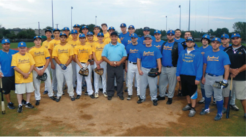 Photo by Jim Hague The 2013 Lyndhurst state champions (l.) took on the 2008 Lyndhurst state champs (r.) in a charity baseball game last week, with coach Butch Servideo (c.) serving as an umpire. The 2008 team won, 10-2.
