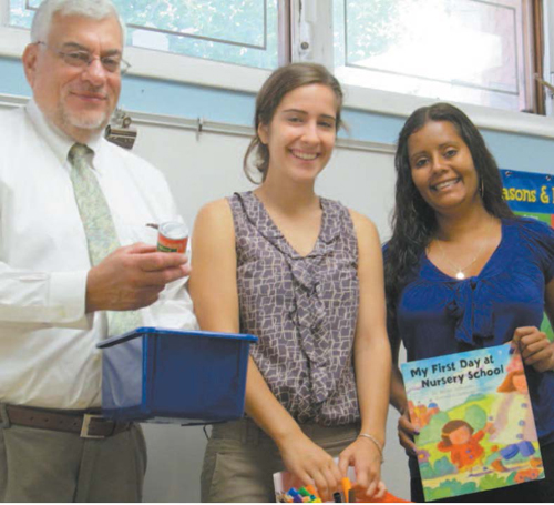 Photo by Ron Leir Sampling some of the wares at new East Newark pre-school, from l., are Superintendent/ Principal William Shlala, teacher aide Joanne Ribeiro and teacher Jennifer Palumbo.