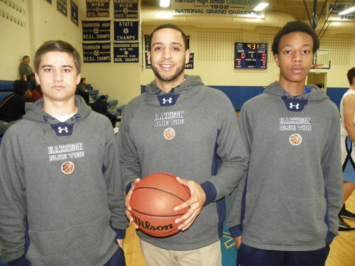 Photo by Jim Hague Harrison has enjoyed a fine 5-2 start to the high school basketball season. From l. are senior Tommy Dolaghan, head coach Noel Colon and senior Jeremy Mohamoud.