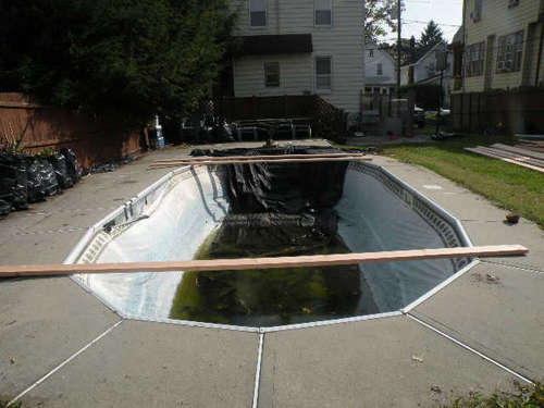 Photo  courtesy Kearny DPW Exposed pool in rear yard of 47 Morgan Place.