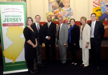 Photo courtesy David Mach At award ceremony, from l., are Jenny and David Mach; PSE&G Service Vice President Richard T. Thigpen, PSE&G Public Relations Director Art Gida, PSE&G Sustainability Manager Angela Ortiz, Sustainable Jersey Board Chair Pam Mount, and Sustainable Jersey Co-Director Randy Solomon.