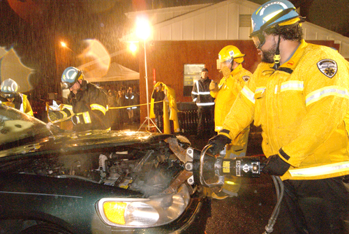Photos by Karen Zautyk Nutley Rescue Squad members dismantle 'wrecked' automobile.