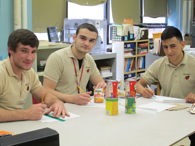 Photo by Ron Leir Seniors Kevin Zajac (l.), club president Anthony Belo (c.) and club vice president Pablo Galarza played key roles.