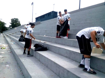 Photos courtesy Joe Fischer Belleville football players climb the stairs at Belleville Stadium to clean the facility after graduation ceremonies recently.