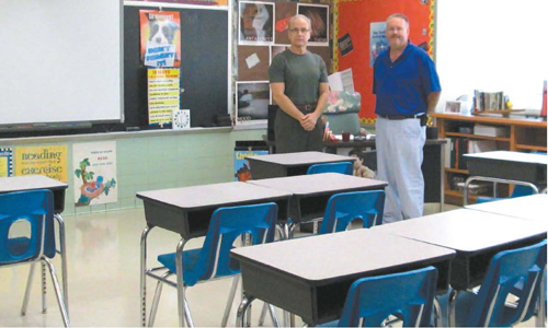 Photo by Ron Leir Patrick Ragnoni (l.) and Robert Zika check out another classroom at Lincoln.