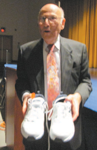 Photo by Ron Leir Belleville students presented a pair of sneakers as a gift to Ganz, who walks a mile and a half every morning.