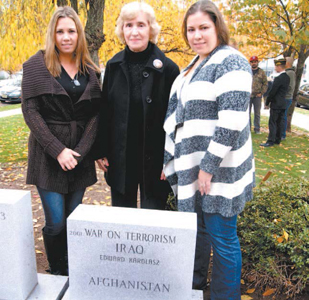 Newest addition to Kearny's Monument Park is a memorial to the War on Terrorism and honoring Staff Sgt. Edward Karolasz, whose mother Krystyna Karolasz (c.), and sister Kristine Lancha (l.) and Donna Kornas attended the dedication.