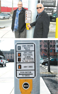 Photos by Ron Leir Lyndhurst Mayor Robert Giangeruso (r.) and consulting engineer Brian Intindola check out one of the pedestrian push-button crossing stations at Kingsland/Riverside Aves. intersection.