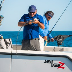 Julio Meza reeling in grouper