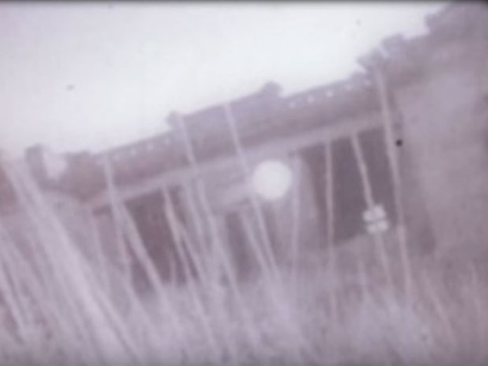 A still of the building featured in the Bitterfoot Footage.