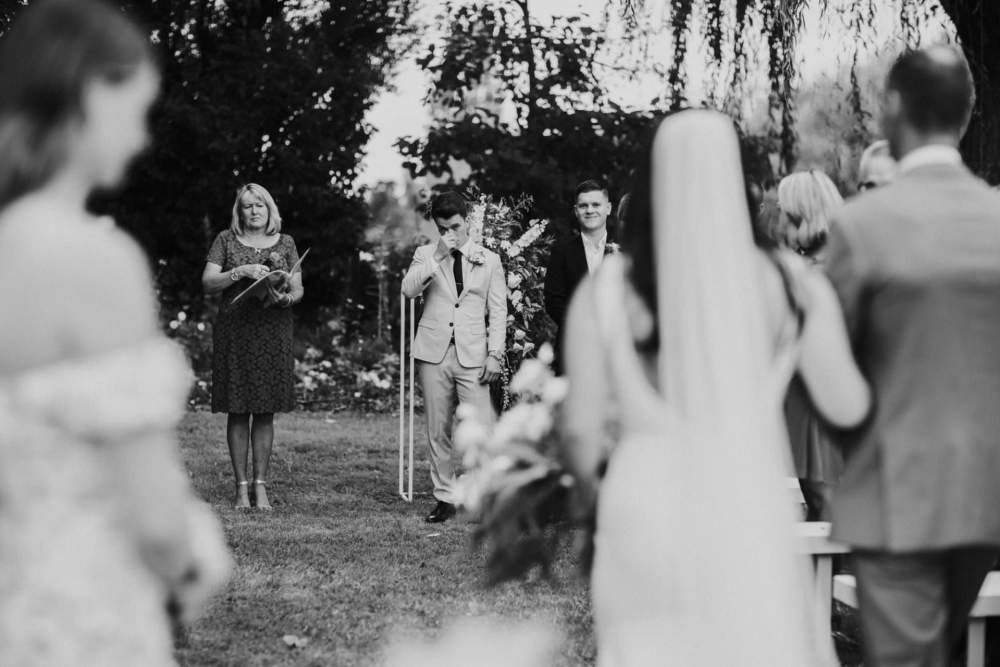 Groom reaction to bride coming down the isle