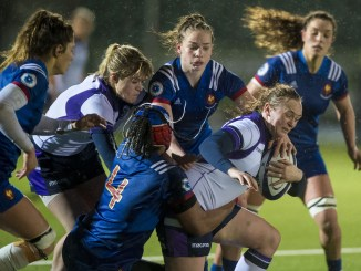 Scotland's Jodie Rettie on the attack against France, with Hannah Smith up in support.