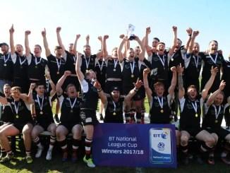 Dumfries Saints players celebrate winning the Natonal League Cup Final.