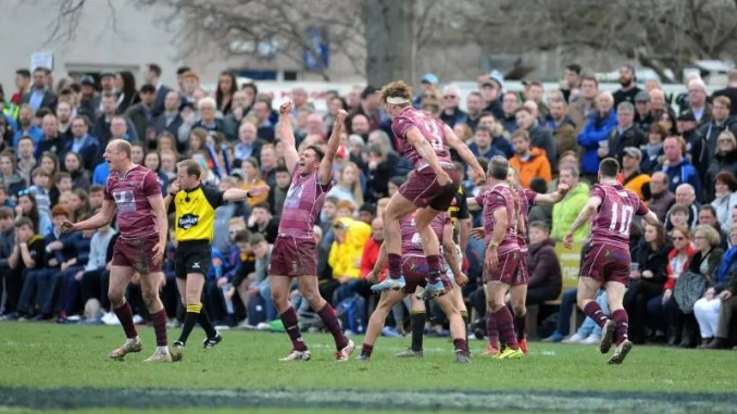 Watsonians players are ecstatic at the end of the match after winning the final against the home side.
