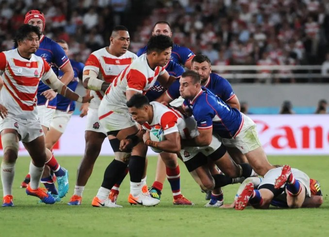 Timothy Lafaele  of Japan centre is tackled by Russia fly half Yury Kushnarev in the tournament opener. Image: Fotosport/David Gibson