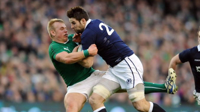 Johnnie Beattie crashes into Ireland centre Luke Marshall during the 2014 Six Nations.