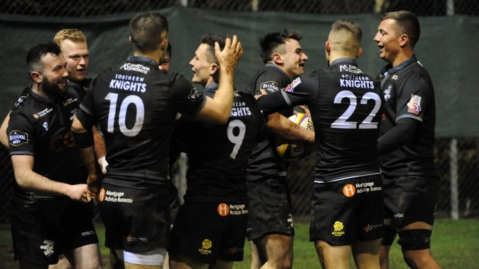 Joseph Jenkins celebrates with his Southern Knights team-mates after scoring a late try against Boroughmuir Bears. Image: David Gibson / Fotosport