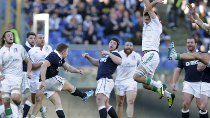 Duncan Weir kicks a dramatic last minute drop goal to snatch victory in Rome in 2014. Image: Fotosport - Roberto Bregani