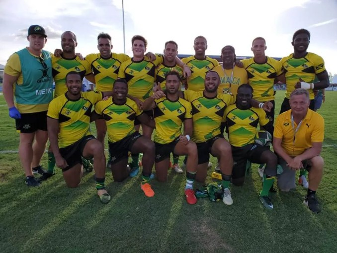 Rhodri Adamson (back row and fourth from left) with his Jamaican Sevens squad team-mates. Scottish coach Steve Lewis is bottom right.