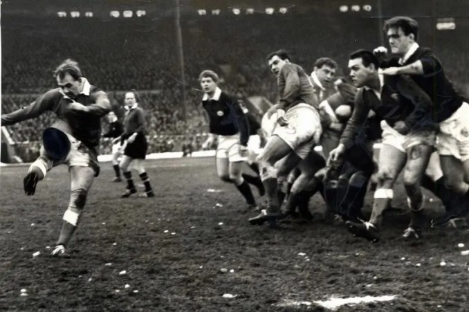 Clive Rowlands kicks again for Wales against Scotland.