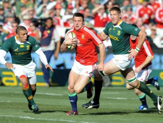 Lions winger Tommy Bowe tries to escape Bryan Habana and Bakkies Botha during the 2009 Test series. Image: Fotosport/David Gibson