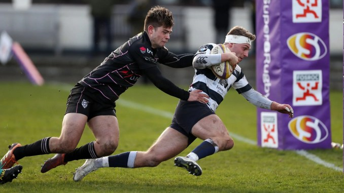 Dan Nutton of Heriots shrugs off Ross Thompson of Ayrshire Bulls to score a try during a Super6 clash in March. Image: FOTOSPORT/DAVID GIBSON