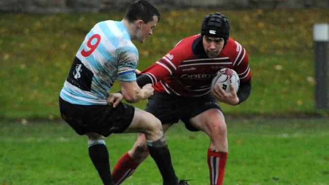 Sam Knudson of Aberdeen Grammar is tackled by Mark Sinclair of Edinburgh Accies during last season's Premiership clash at Newfield. Image: Fotosport/David Gibson
