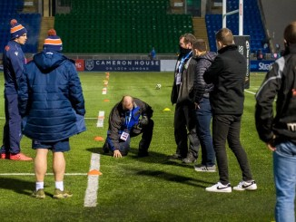The Scotstoun ground staff along with match officials and Edinburgh captain Stuart Mcinally inspect the playing surface before the decision was made to call off this evening's 1872 Cup clash. Image: Craig Watson