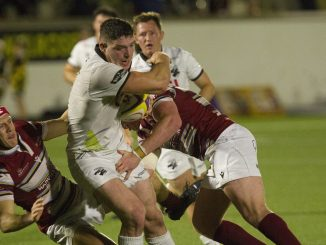 Southern Knights openside Allan Ferrie is tackled. Image: Bill McBurnie