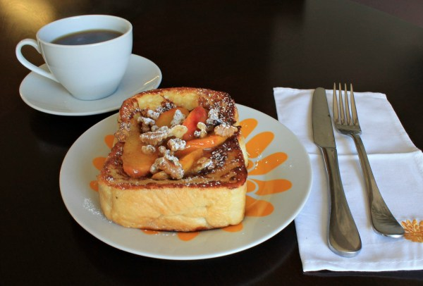 French Toast on colorful plate with a cup of coffee and cloth napkin