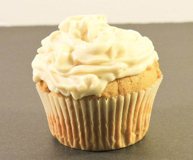 Pumpkin Muffin with Frosting on table